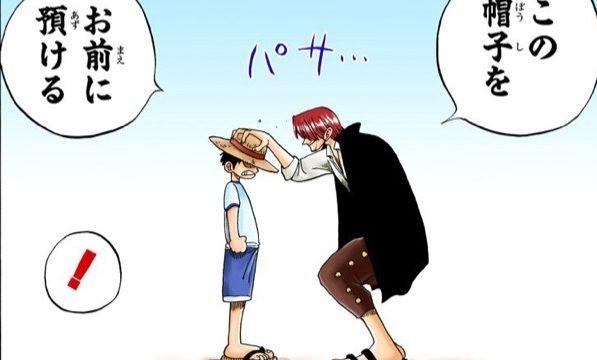赤髪のシャンクスが少年のルフィに麦わら帽子を預ける場面